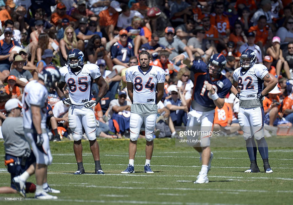 Denver Broncos TE Virgil Green (85) Jacob Tamme (84) Jake O'Connell (82) watch QB Peyton Manning (18) run the offense during training camp August 5, 2013 at Dove Valley.