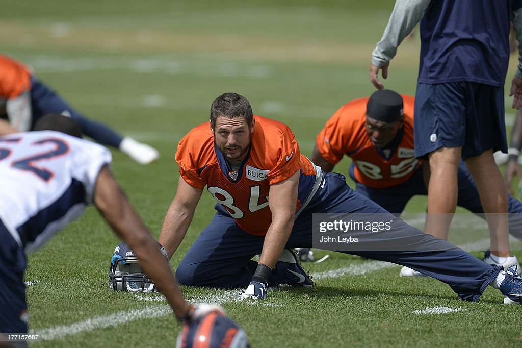 Denver Broncos tight end Jacob Tamme (84) stretches during practice August 22, 2013 at Dove Valley