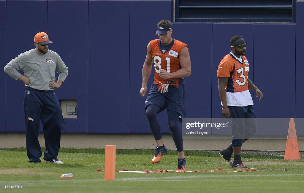 Denver Broncos tight end Joel Dreessen (81) and Denver Broncos running back Jeremiah Johnson (37) workout during practice August 22, 2013 at Dove Valley