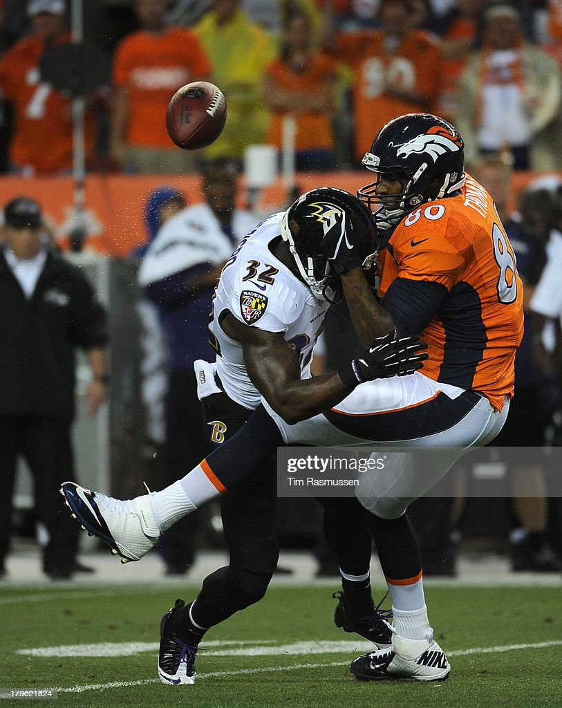 Denver Broncos tight end Julius Thomas (80) gets tackled by Baltimore Ravens strong safety James Ihedigbo (32) in the first quarter. The Denver Broncos took on the Baltimore Ravens in the first game of the 2013 season at Sports Authority Field at Mile High in Denver on September 5, 2013.