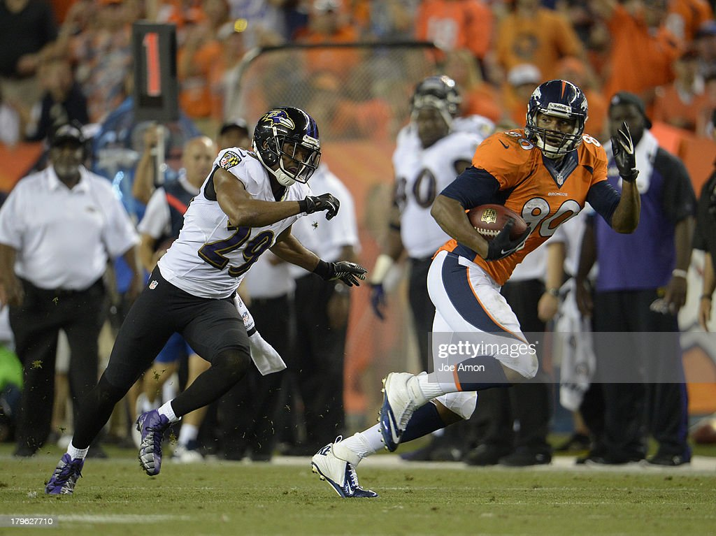 Denver Broncos tight end Julius Thomas (80) makes a catch for a first down in the second quarter. The Denver Broncos took on the Baltimore Ravens in the first game of the 2013 season at Sports Authority Field at Mile High in Denver on September 5, 2013.