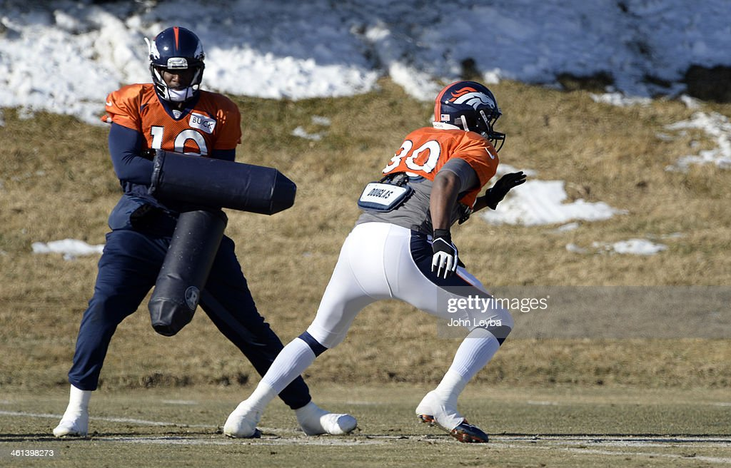 Denver Broncos tight end Julius Thomas (80) runs through drills with Denver Broncos wide receiver Gerell Robinson (10) during practice January 8, 2014 at Dove Valley. The Denver Broncos are preparing for their Divisional Game against the San Diego Chargers at Sports Authority Field.