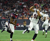 Denver Broncos tight end Owen Daniels catches a pass in front of Houston Texans defensive back Eddie Pleasant during the first quarter August 22 2015...