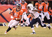 Denver Broncos tight end Owen Daniels pics up a few yards after his catch in front of San Diego Chargers cornerback Adrian Phillips during the second...