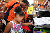 Denver Broncos tight end Virgil Green #85 shops with Alize Keys in front for school supplies at King Soopers Marketplace on July 25 2016 in Parker...