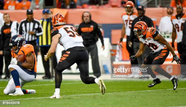 Denver Broncos tight end Virgil Green drops to his knee to catch a low pass as Cincinnati Bengals outside linebacker Nick Vigil and Cincinnati...