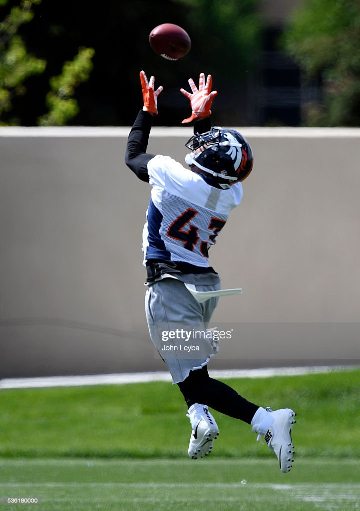 Denver Broncos <a gi-track='captionPersonalityLinkClicked' href=/galleries/search?phrase=T.J.+Ward&family=editorial&specificpeople=4640262 ng-click='$event.stopPropagation()'>T.J. Ward</a> (43) catches a pass over his shoulder during OTA's May 31, 2016 at UCHealth Training Facility, Dove Valley.