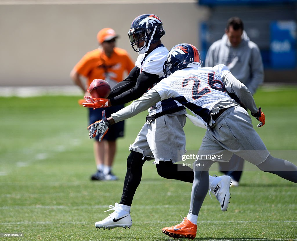 Denver Broncos <a gi-track='captionPersonalityLinkClicked' href=/galleries/search?phrase=T.J.+Ward&family=editorial&specificpeople=4640262 ng-click='$event.stopPropagation()'>T.J. Ward</a> (43) works on drills with <a gi-track='captionPersonalityLinkClicked' href=/galleries/search?phrase=Darian+Stewart&family=editorial&specificpeople=4542671 ng-click='$event.stopPropagation()'>Darian Stewart</a> (26) during OTA's May 31, 2016 at UCHealth Training Facility, Dove Valley.