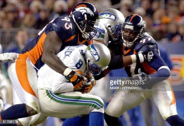 Denver Broncos Trevor Pryce sacks Seattle Seahawks quarterback Matt Hasselbeck for a fiveyard loss 09 December 2001 at Mile High Stadium in Denver...