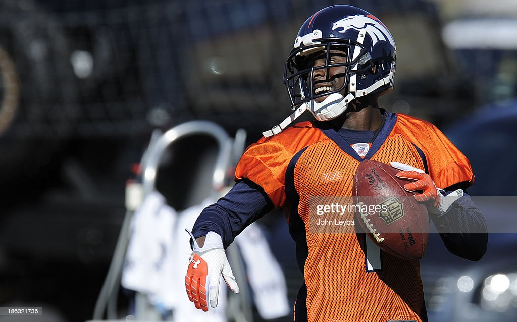 Denver Broncos <a gi-track='captionPersonalityLinkClicked' href=/galleries/search?phrase=Trindon+Holliday&family=editorial&specificpeople=4045241 ng-click='$event.stopPropagation()'>Trindon Holliday</a> (11) smiles after catching a pass during practice on October 30, 2013 at Dove Valley. The players swapped jerseys for Halloween.