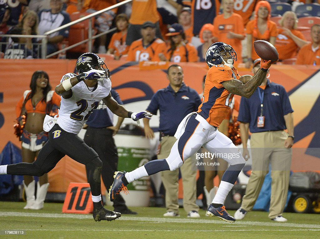 Denver Broncos wide receiver Andre Caldwell (12) makes a catch for a touchdown to open the third quarter. The Denver Broncos took on the Baltimore Ravens in the first game of the 2013 season at Sports Authority Field at Mile High in Denver on September 5, 2013.