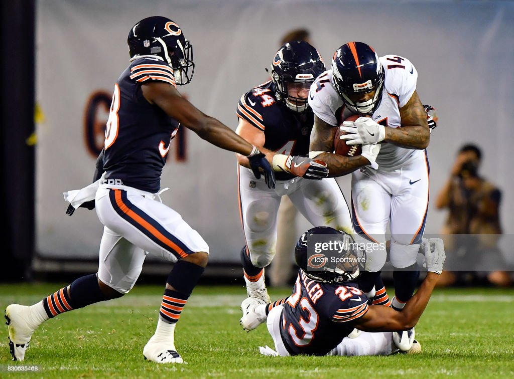 Denver Broncos wide receiver Cody Latimer (14) is tackled by Chicago Bears cornerback Kyle Fuller (23) during the preseason game between the Denver Broncos and the Chicago Bears on August 10, 2017 at Soldier Field in Chicago, Illinois.