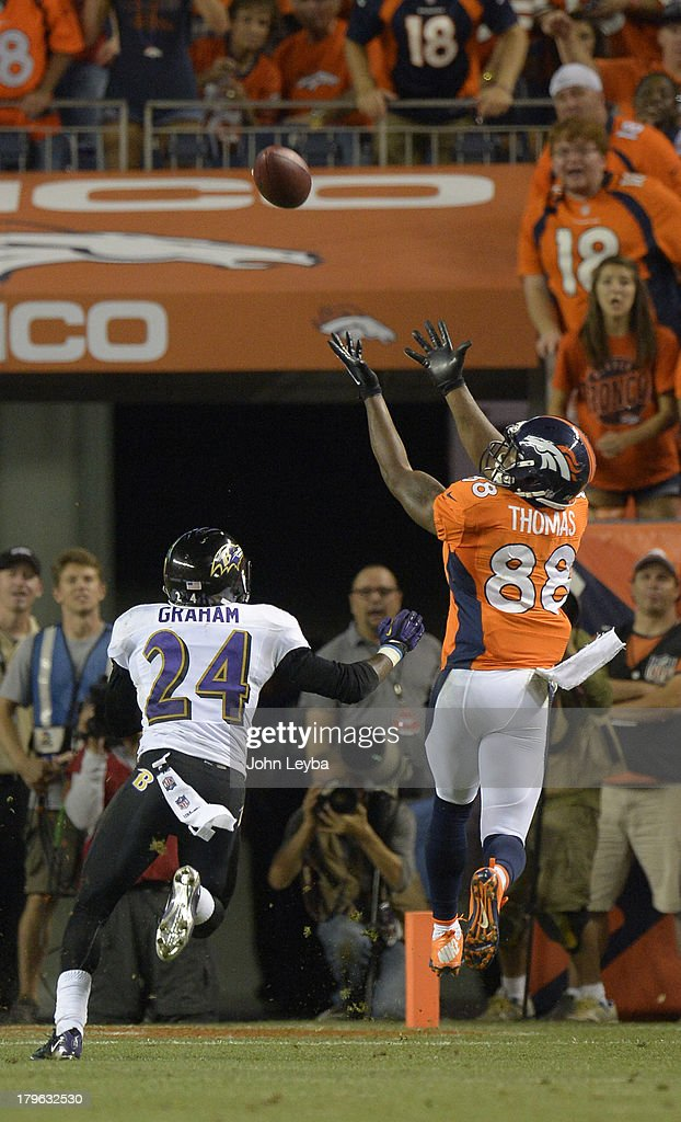 Denver Broncos wide receiver Demaryius Thomas (88) catches a touchdown pass in the third quarter. The Denver Broncos took on the Baltimore Ravens in the first game of the 2013 season at Sports Authority Field at Mile High in Denver on September 5, 2013.