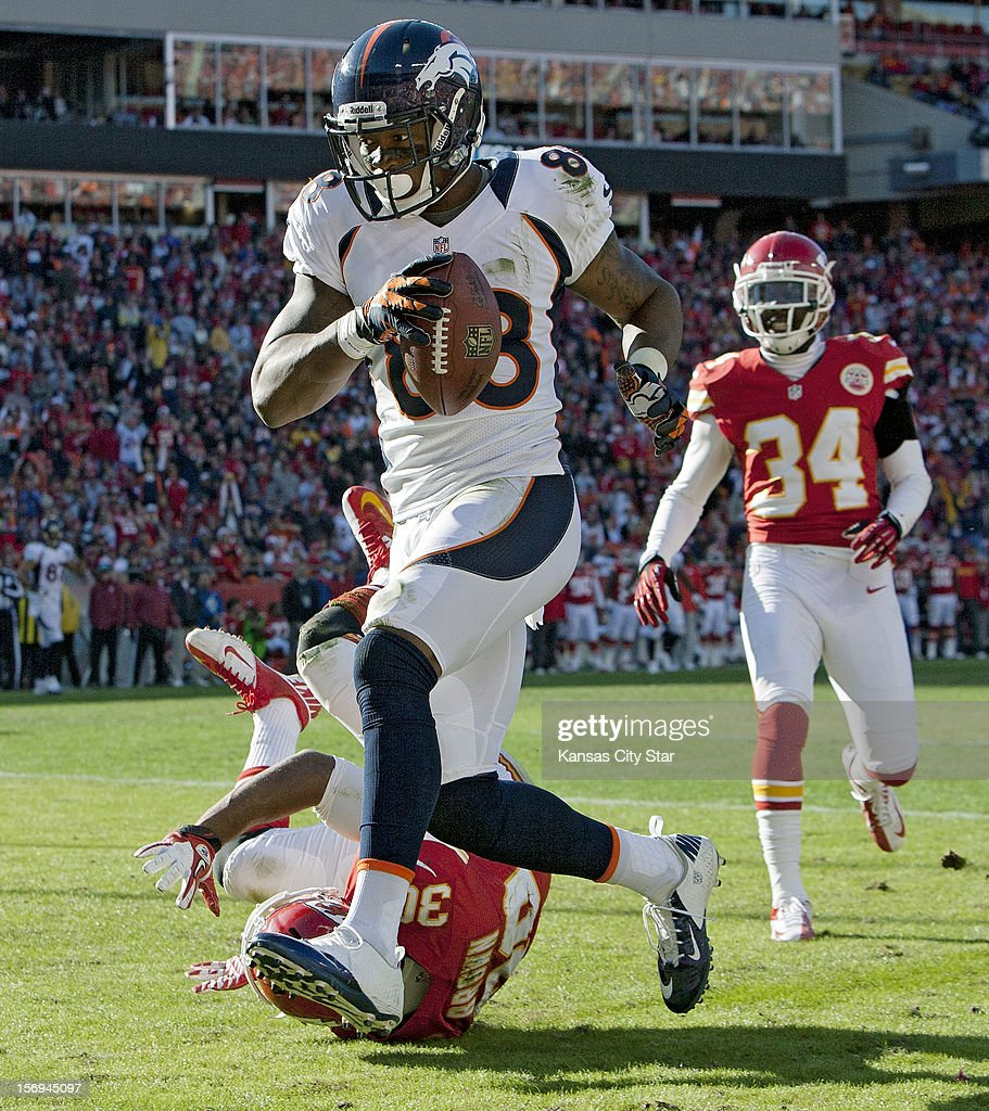 Denver Broncos wide receiver Demaryius Thomas (88) hauls in a touchdown pass in front of Kansas City Chiefs defensive back Jalil Brown (30) in the third quarter at Arrowhead Stadium on Sunday, November 25, 2012, in Kansas City, Missouri. The Denver Broncos defeated the Kansas City Chiefs, 17-9.