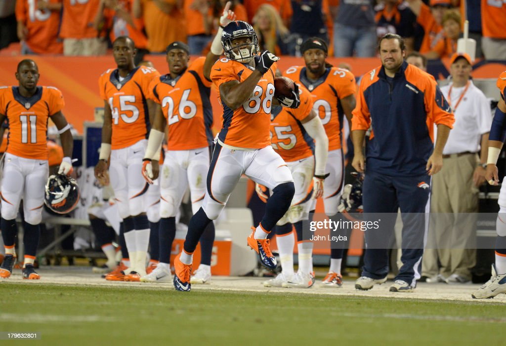 Denver Broncos wide receiver Demaryius Thomas (88) makes a run down the sidelines in the third quarter. The Denver Broncos took on the Baltimore Ravens in the first game of the 2013 season at Sports Authority Field at Mile High in Denver on September 5, 2013.