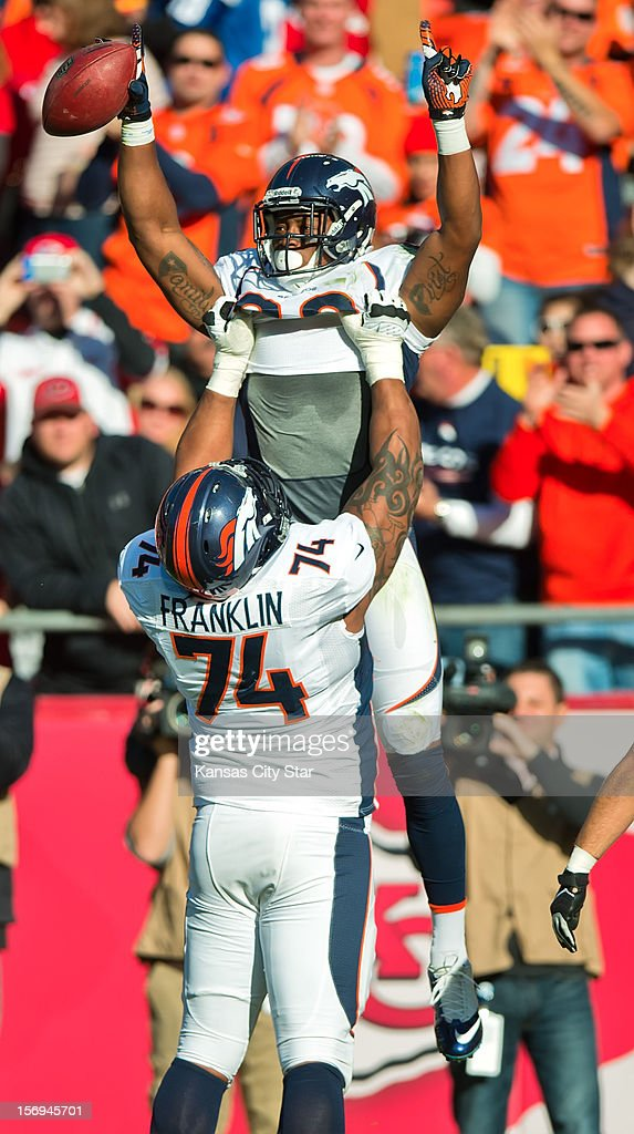 Denver Broncos wide receiver Demaryius Thomas (88) was lifted by his teammate Orlando Franklin (74) after Thomas' third quarter touchdown against the Kansas City Chiefs at Arrowhead Stadium on Sunday, November 25, 2012, in Kansas City, Missouri. The Denver Broncos defeated the Kansas City Chiefs, 17-9.