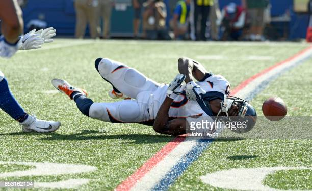 Denver Broncos wide receiver Emmanuel Sanders can't come up with a catch on fourth down late int eh fourth quarter against the Buffalo Bills on...