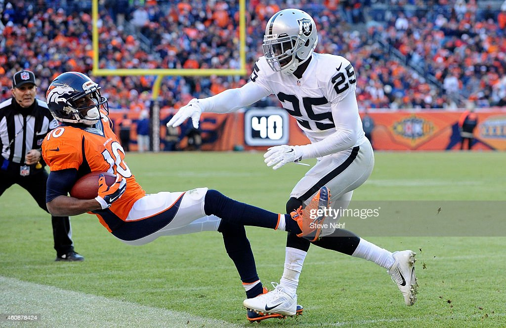 Denver Broncos wide receiver Emmanuel Sanders his knocked out of bounds by Oakland Raiders cornerback DJ Hayden in the second quarter at Sports...