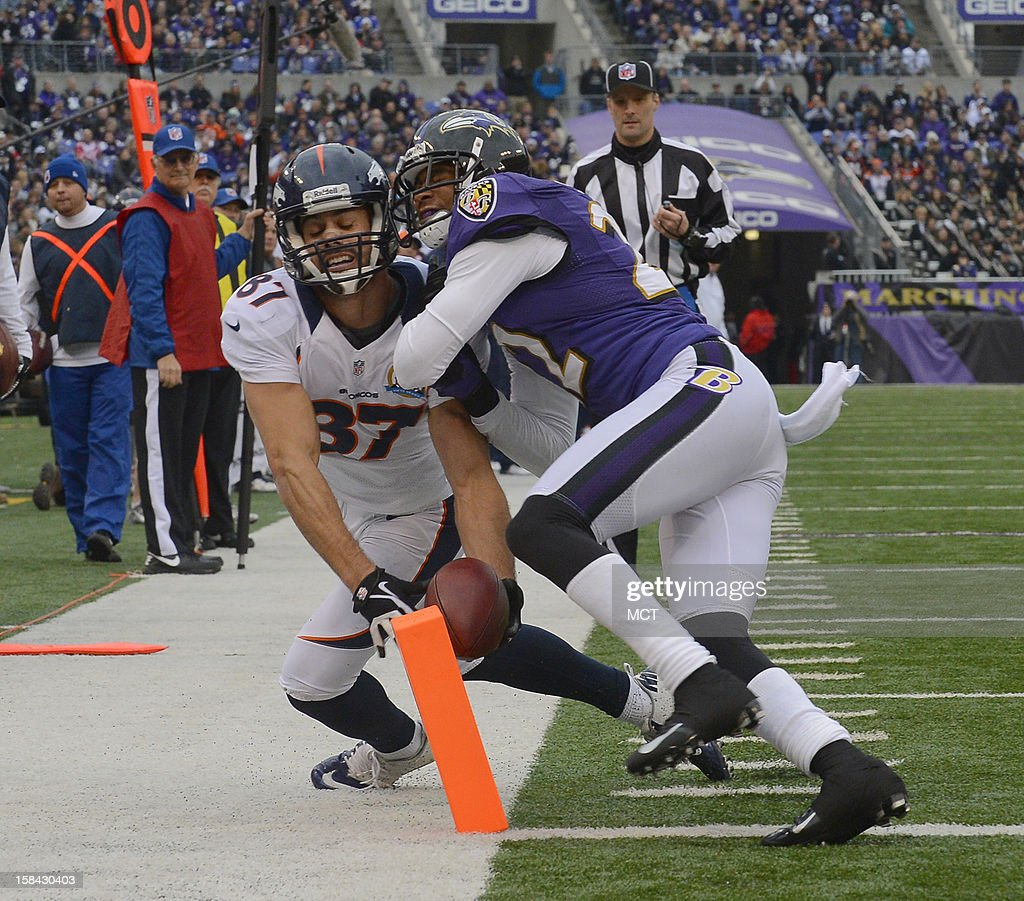 Denver Broncos wide receiver Eric Decker attempts to hit the pylon after a reception near the goal line as Baltimore Ravens cornerback Jimmy Smith defends in the first half of their game in Baltimore, Maryland, on Sunday, December 16, 2012.