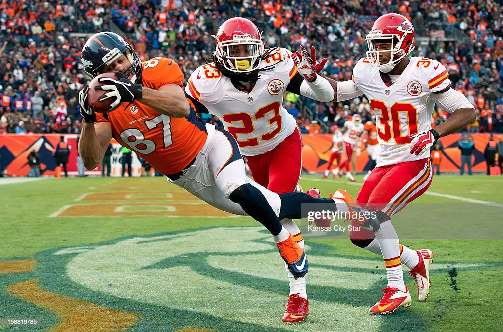 Denver Broncos wide receiver Eric Decker (87) caught a second-quarter touchdown past the defense of Kansas City Chiefs free safety Kendrick Lewis (23) and defensive back Jalil Brown (30) during NFL action on Sunday, December 30, 2012, at Sports Authority Field in Denver, Colorado.