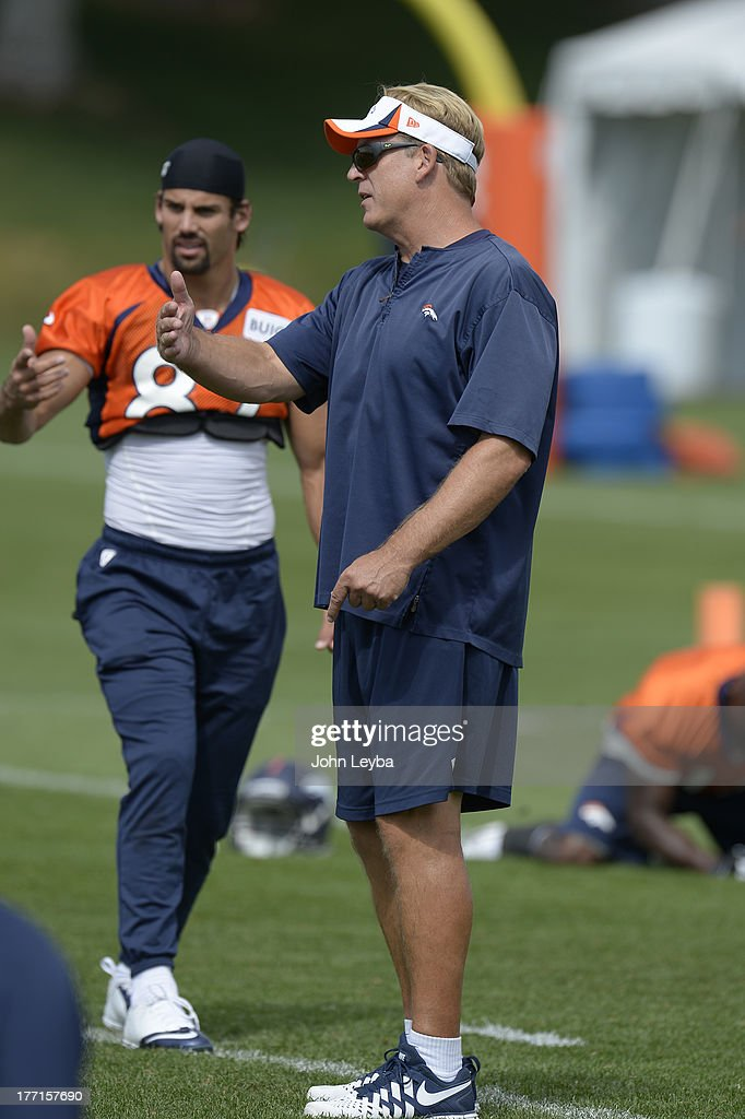 Denver Broncos wide receiver Eric Decker (87) chats with defensive coordinator Jack Del Rio during practice August 22, 2013 at Dove Valley