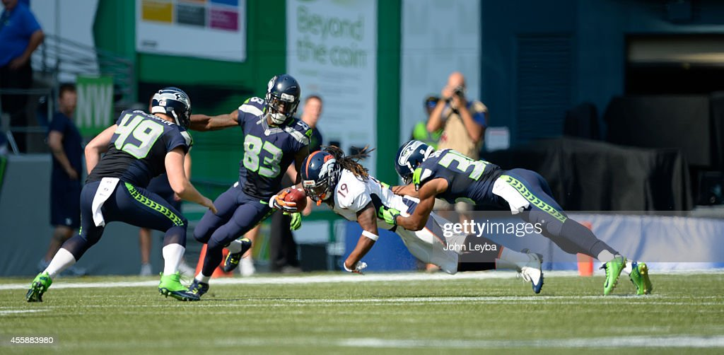 Denver Broncos wide receiver <a gi-track='captionPersonalityLinkClicked' href=/galleries/search?phrase=Isaiah+Burse&family=editorial&specificpeople=7228109 ng-click='$event.stopPropagation()'>Isaiah Burse</a> (19) stretches out for extra yards after a punt return agains the Seahawks September 21, 2014 at CenturyLink Stadium.