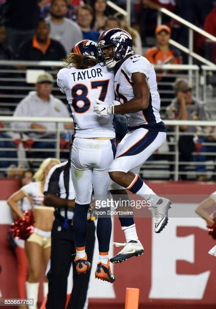Denver Broncos Wide Receiver Jordan Taylor celebrates with Denver Broncos Wide Receiver Bennie Fowler III after catching a pass for a touchdown in...