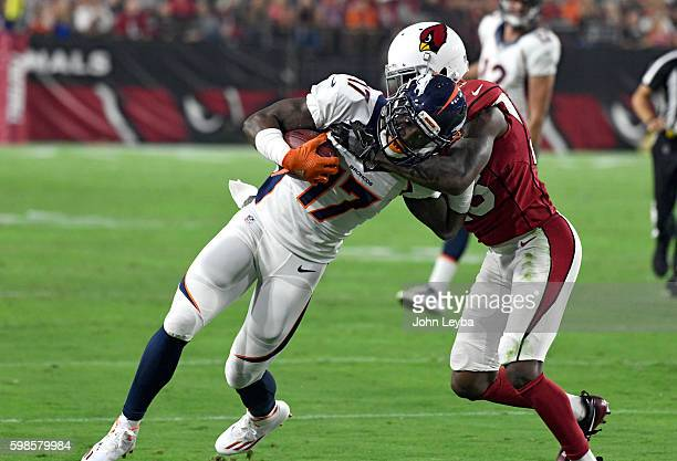 Denver Broncos wide receiver Mose Frazier gets wrapped up by Arizona Cardinals cornerback Brandon Williams after his catch during the first quarter...