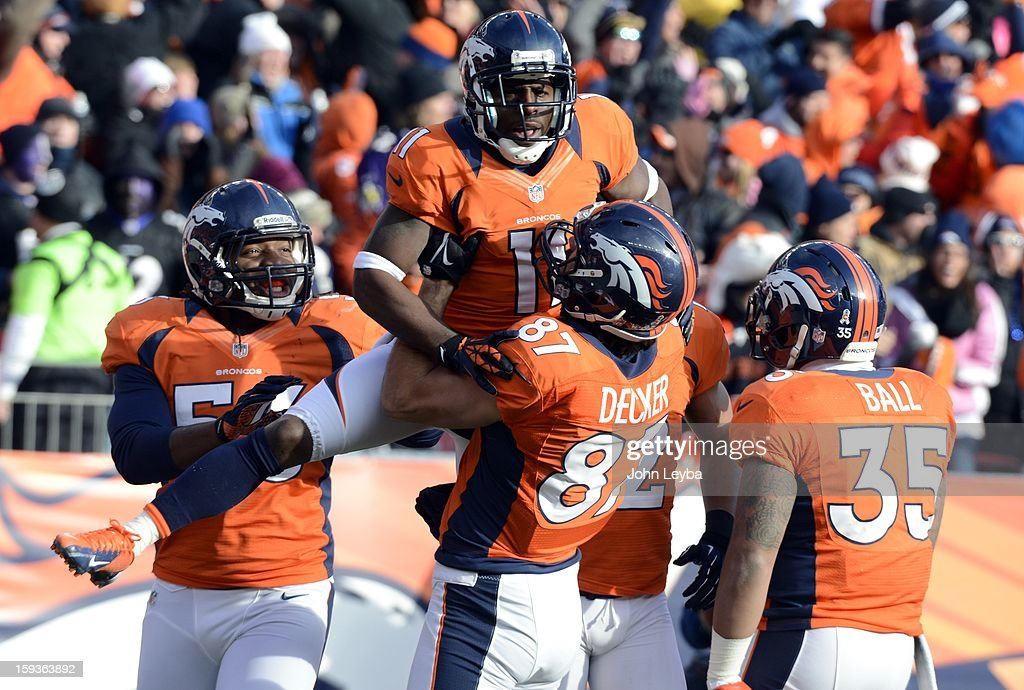 Denver Broncos wide receiver Trindon Holliday (11) celebrates with teammates after scoring a touchdown on an 89 yard punt return early in the first quarter. The Denver Broncos vs Baltimore Ravens AFC Divisional playoff game at Sports Authority Field Saturday January 12, 2013.