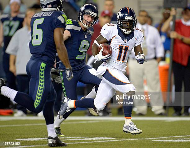 Denver Broncos wide receiver Trindon Holliday gets chased by Seattle Seahawks wide receiver Perez Ashford and Seattle Seahawks punter Jon Ryan as he...