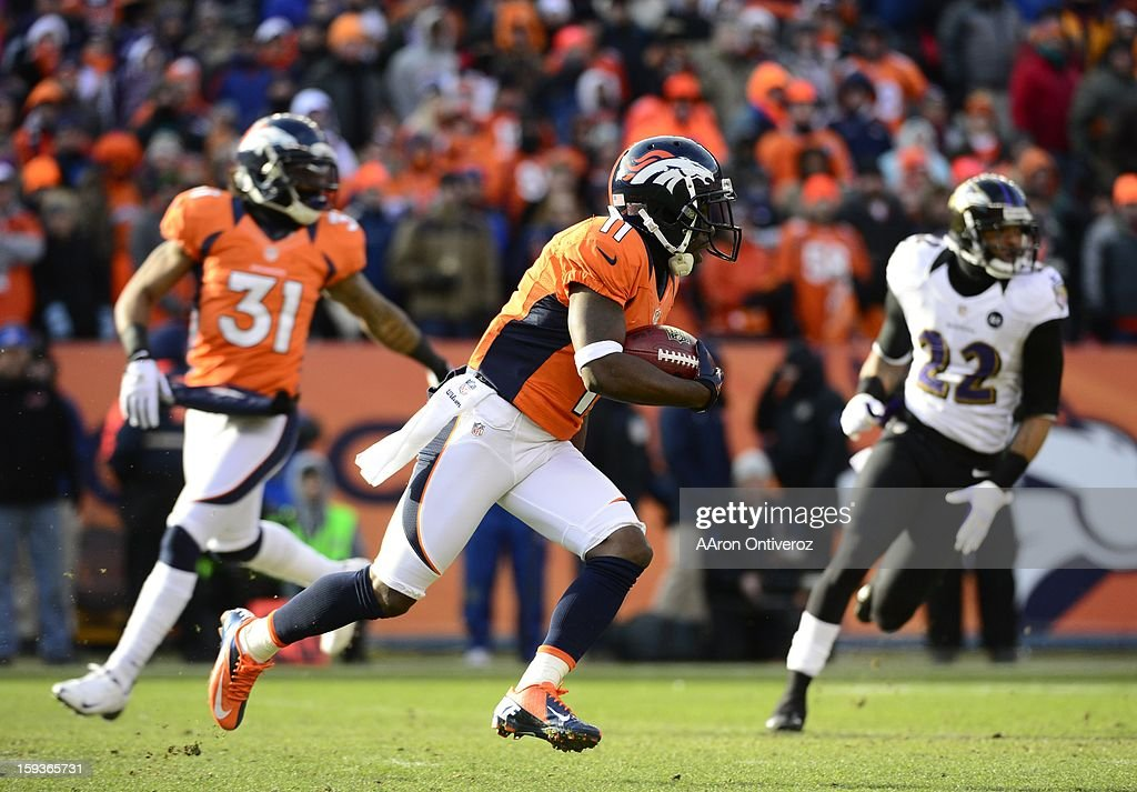Denver Broncos wide receiver Trindon Holliday (11) runs back a punt for an 89-yard touchdown on the Broncos' first offensive play in the first quarter. The Denver Broncos vs Baltimore Ravens AFC Divisional playoff game at Sports Authority Field Saturday January 12, 2013.