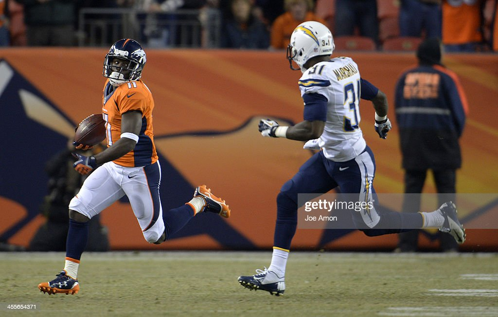 Denver Broncos wide receiver <a gi-track='captionPersonalityLinkClicked' href=/galleries/search?phrase=Trindon+Holliday&family=editorial&specificpeople=4045241 ng-click='$event.stopPropagation()'>Trindon Holliday</a> (11) runs back the kick off to start the gam. The Denver Broncos vs. the San Diego Chargers at Sports Authority Field at Mile High in Denver on December 12, 2013.