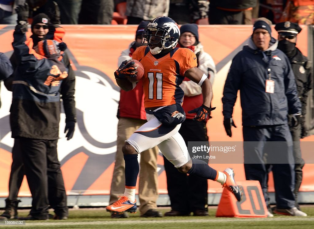 Denver Broncos wide receiver Trindon Holliday (11) scores a touchdown on an 89 yard punt return early in the first quarter. The Denver Broncos vs Baltimore Ravens AFC Divisional playoff game at Sports Authority Field Saturday January 12, 2013.