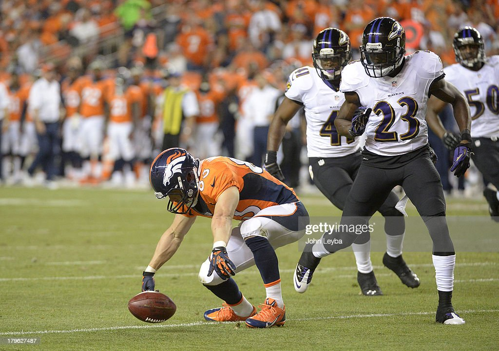 Denver Broncos wide receiver Wes Welker (83) fumbles the ball in the second quarter. The Denver Broncos took on the Baltimore Ravens in the first game of the 2013 season at Sports Authority Field at Mile High in Denver on September 5, 2013.