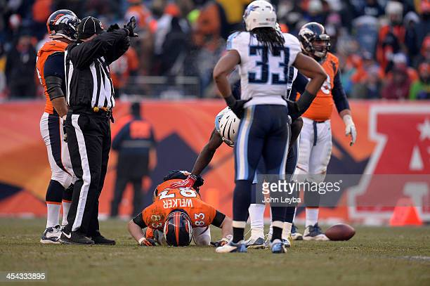 Denver Broncos wide receiver Wes Welker lays on the field after getting a concussion in the second quarter The Denver Broncos take on the Tennessee...