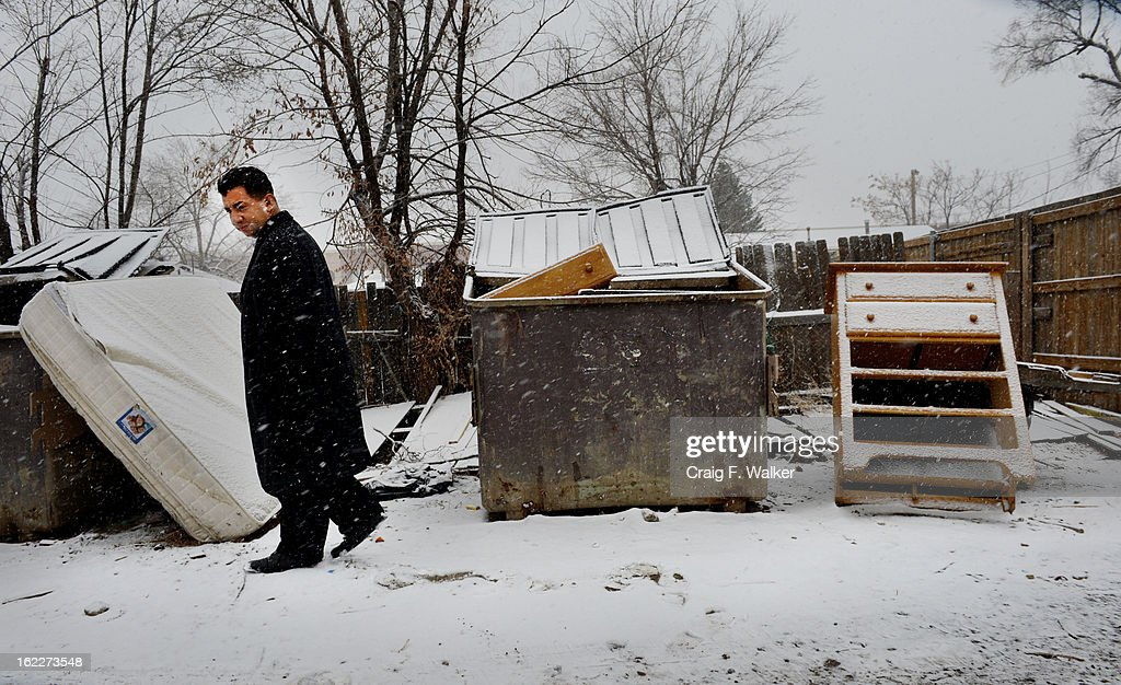 Denver City Councilman Paul Lopez passes a discarded mattress and dresser in an alley while touring the Westwood neighborhood of Denver, CO February 20, 2013. Lopez is concerned about illegal dumping in the area and is pushing for a tougher ordinance in the city. 'We have to get people to realize this neighborhood is not a dumping ground,' Lopez said. 'We refuse to be treated like this.'