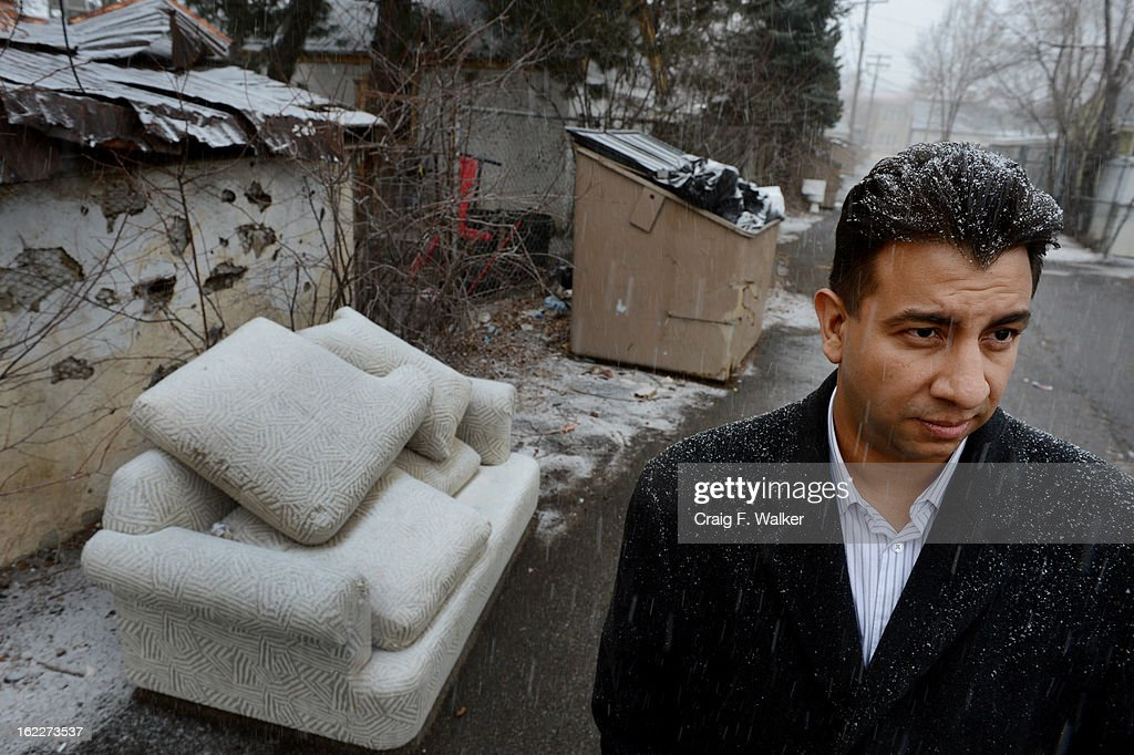Denver City Councilman Paul Lopez poses for a portrait near a discarded sofa in the Barnum neighborhood of Denver, CO February 20, 2013. Lopez is concerned about illegal dumping in local alleys and is pushing for a tougher ordinance in the city. 'We have to get people to realize this neighborhood is not a dumping ground,' Lopez said. 'We refuse to be treated like this.'