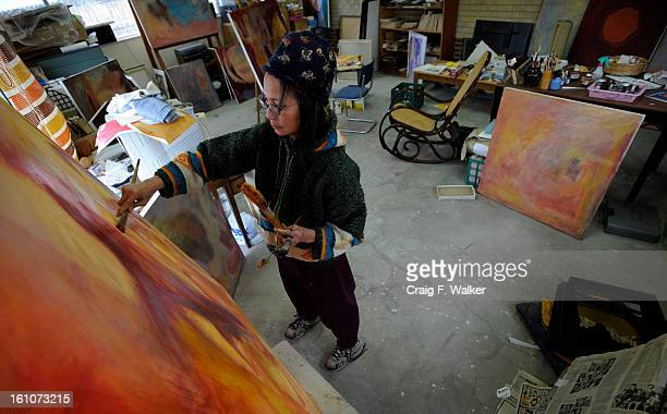 NUN_010907_CFW Denver CO Sister Sen Nguyen works on a series of contemporary oil paintings at her home studio in Denver CO Nguyen a member of the...