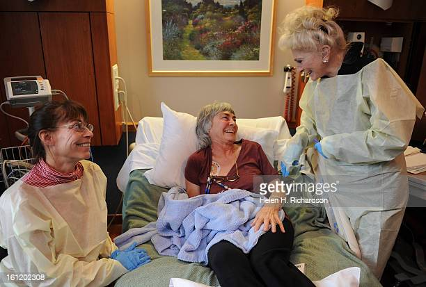 Denver ColoSinger songwriter Judy Collins jokes with cancer patient Eleanor Martin middle and her daughter Lauretta Neff left Martin who has multiple...