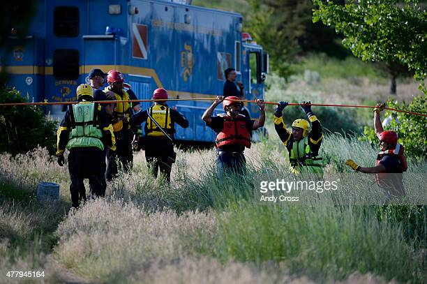 Denver Fire and a Denver Fire Water Rescue team anchor rope across the South Platte River providing support for a reported tubing accident victim...