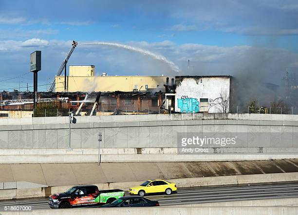 Denver firefighters work a large fire at the abandoned Rockies Inn at Evans Ave near I25 April 01 2016