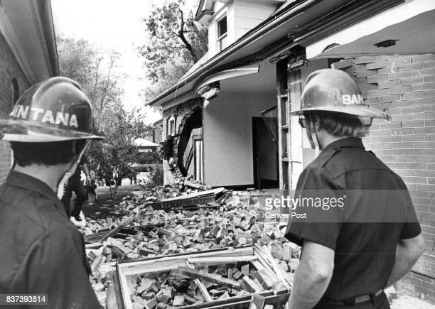 Denver Firemen Survey Remains Of An Entire Brick Wall Knocked Out By Gas Explosion At House At 476 SLogan St The house was undergoing renovation and...