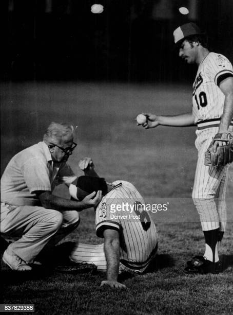 Denver First Baseman 'Out' as Pickoff Misfires Trainer Joe Carroll assists Roger Freed who ran into base runner while chasing ball now held by Jim...