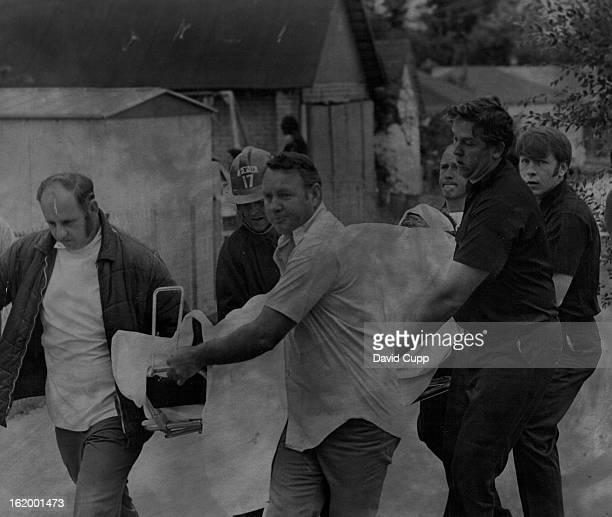 JUL 4 1972 Denver General Hospital Attendants And Denver Firemen Carry Detective Cliff Stanley To Ambulance After Bomb Explosion Stanley And Police...