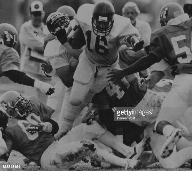 POST Denver Gold running back Dennis Mosley loaded through a tangled ma33 of bodies for yardage during a controlled scrimmage between the Gold and...