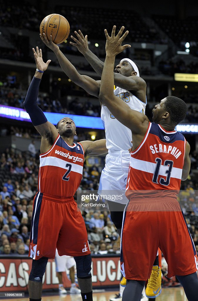 Denver guard Ty Lawson cut between Washington defender John Wall and Kevin Seraphin in the first half. The Denver Nuggets hosted the Washington Wizard at the Pepsi Center Friday night, January 18, 2013. Karl Gehring/The Denver Post via Getty Images