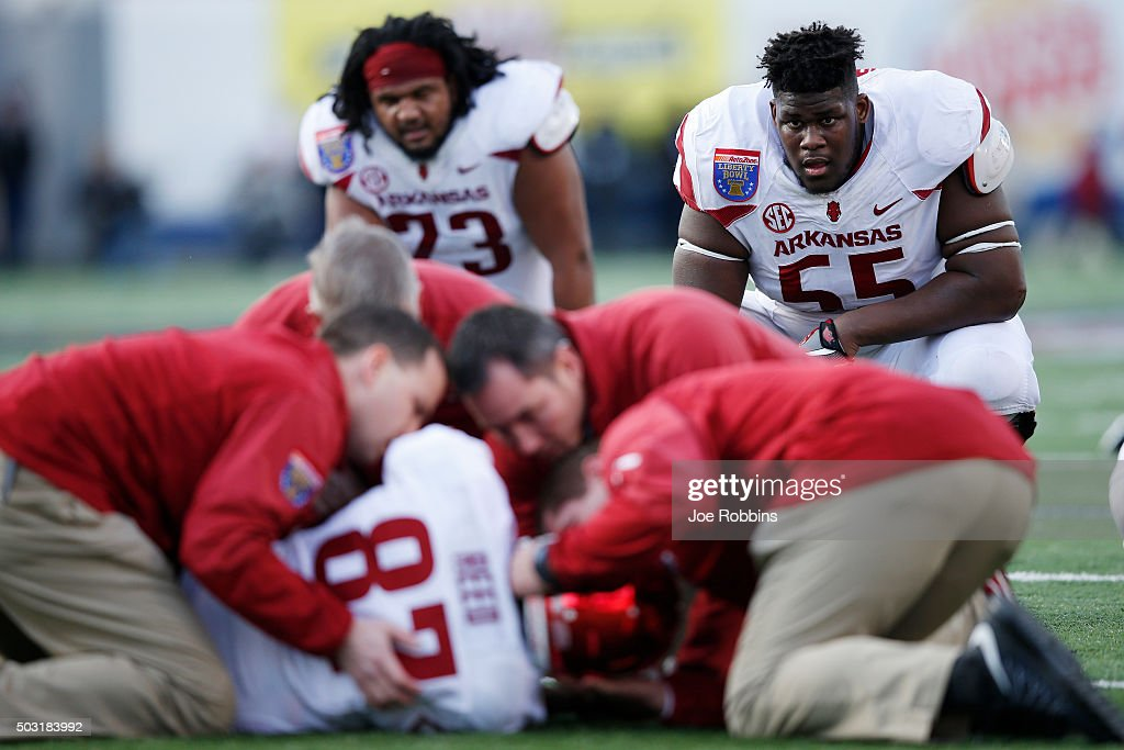 Denver Kirkland of the Arkansas Razorbacks watches as teammate Dominique Reed is checked out after suffering a neck injury against the Kansas State...