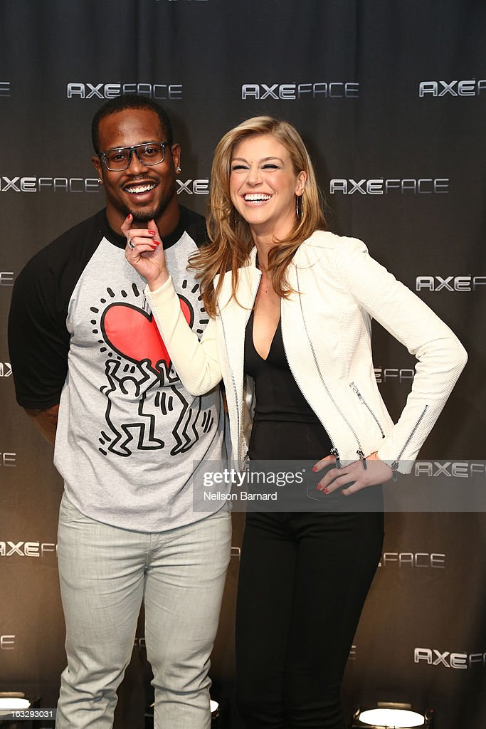 Denver linebacker Von Miller and action film star Adrianne Palicki get playful at the AXE Facescore event on March 5, 2013 in New York City.