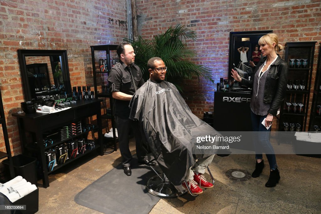 Denver linebacker <a gi-track='captionPersonalityLinkClicked' href=/galleries/search?phrase=Von+Miller&family=editorial&specificpeople=7125735 ng-click='$event.stopPropagation()'>Von Miller</a> (C) and celebrity stylist Amy Komorowski demonstrate the new AXE Face range and Shave line at the AXE Facescore event at Drive-In Studio on March 5, 2013 in New York City.
