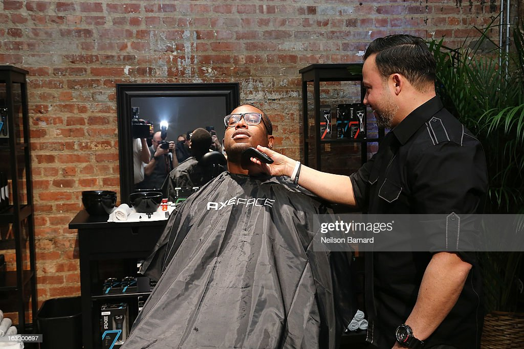 Denver linebacker <a gi-track='captionPersonalityLinkClicked' href=/galleries/search?phrase=Von+Miller&family=editorial&specificpeople=7125735 ng-click='$event.stopPropagation()'>Von Miller</a> (L) gets a clean shave at the AXE Facescore event at Drive-In Studio on March 5, 2013 in New York City.